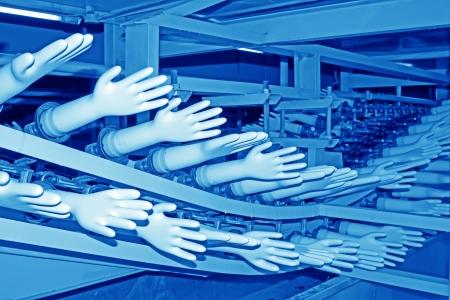 closeup of acrylonitrile butadiene gloves production line  Banco de Imagens