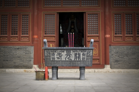 censer and wooden window lattice in a temple , north china Stock Photo - 13626787