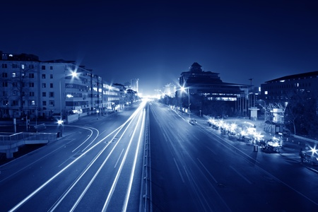 light trails on the modern street at night in beijing financial center, China  photo