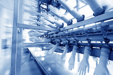 closeup of acrylonitrile butadiene gloves production line in a factory, north china  Stock Photo