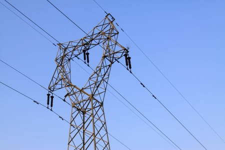 electric tower in the blue sky, steel power transmission facilities photo