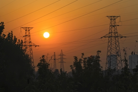 setting sun and electric towers, looks very beautiful and quiet Stock Photo - 17601714