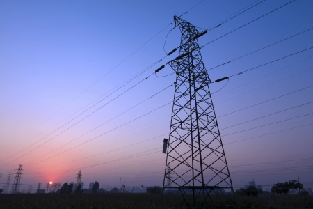 setting sun and electric towers, looks very beautiful and quiet Stock Photo - 17601729