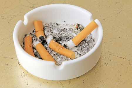 ashtray: cigarettes in a ashtray on a marble table