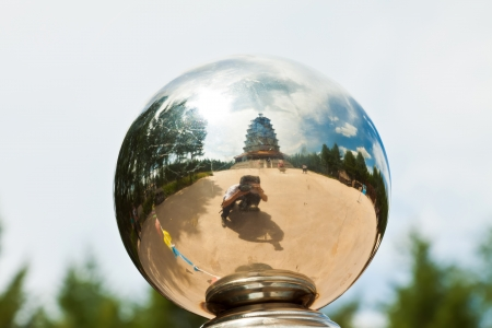 photographer and pagoda in a metal ball in a park Stock Photo - 19190273