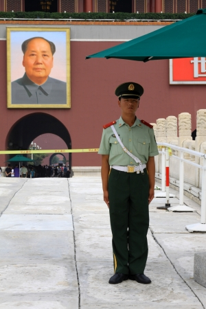 BEIJING - August 29  A soldier stands guard while people visit the Palace Museum on August 29, 2011 in Beijing, China  The collections of the Palace Museum are well protected and are based on Qing imperial