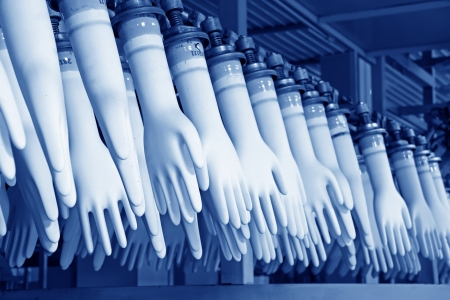 industrial automation: closeup of acrylonitrile butadiene gloves production line in a factory, north china