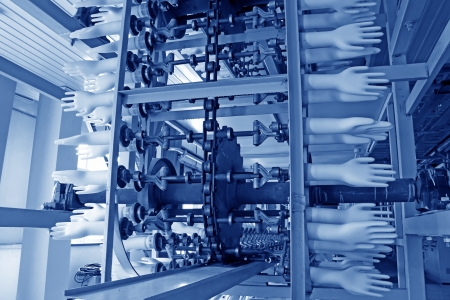 rubber glove: closeup of acrylonitrile butadiene gloves production line in a factory, north china