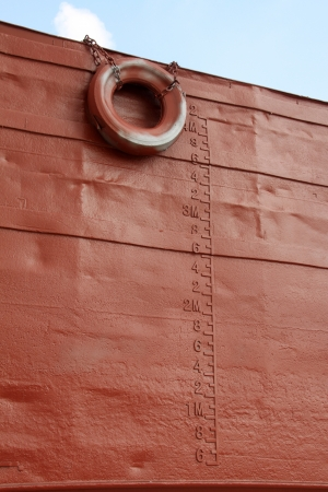 closeup of pictures, waterline and rubber tire marked on the ship Stock Photo - 19585311