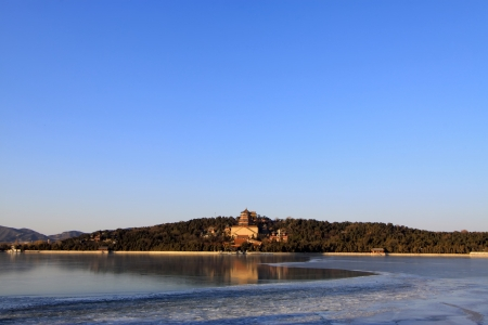 The Summer Palace, Beijing, December 10th  Tower of Buddhist incense and frozen Kunming lake in the Summer Palace on December 10, 2011, Beijing, china  photo