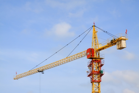 crane tower under the blue sky, at a construction site, north china photo