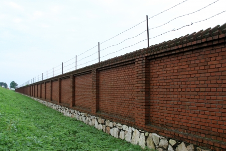 Barb wire into a prison wall, Luannan, Hebei, China. photo