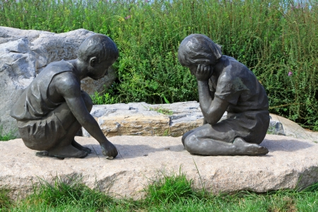 children playing games, closeup of stone carving works