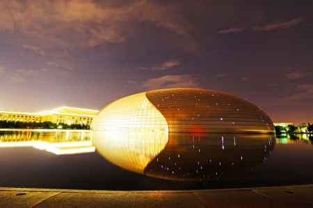 great hall: The National Grand Theatre and the Great Hall of the people at night on September 13, 2012, in Beijing, china