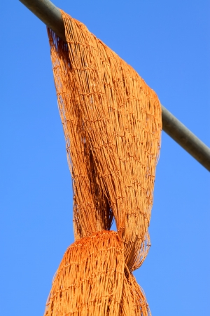 Suspension of fishing nets in the blue sky background photo