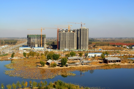 unfinished building: unfinished building by the water in China