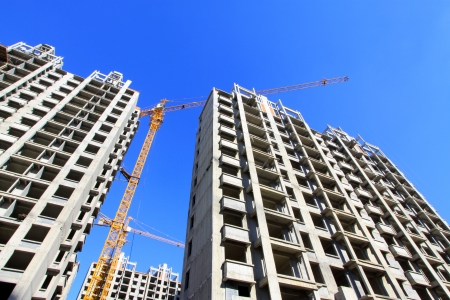 unfinished building: unfinished building under the blue sky, in China Editorial