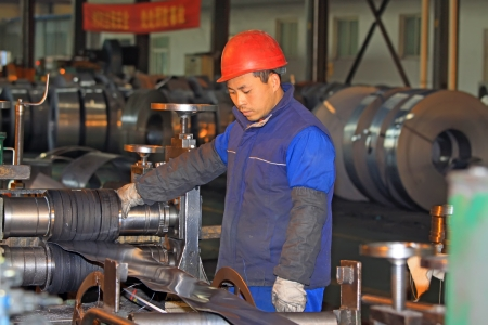 Luannan, November 19  A worker operating the machine, in Huifeng Steel Corp workshop, in November 19, 2012  Huifeng Steel Corp specializing in the production of hot rolled strip, is the largest local refined steel manufacturers