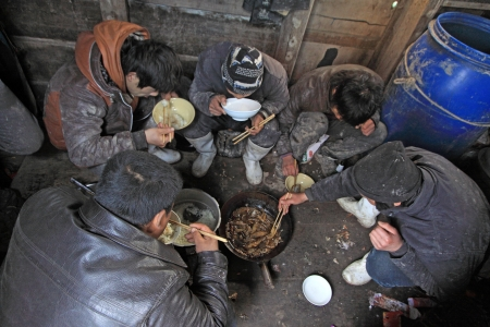 stenosis: Luannan County, April 1  Workers were having lunch in the cabin of fishing boat in the ZuiDong fishing Wharf on April 1, 2012, Luannan County, Hebei Province, China