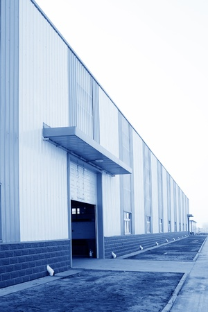 warehouse building: door of a warehouse, in manufacturing building exterior Stock Photo