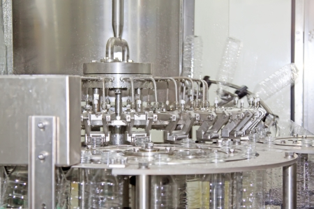 mechanization: bottled mineral water production line in a factory Stock Photo