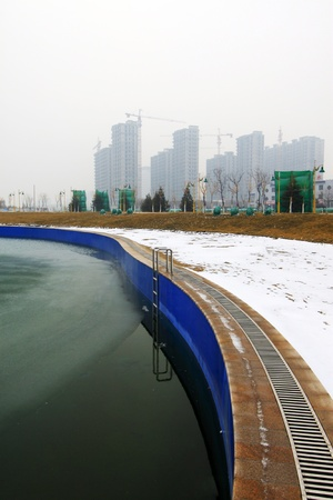 outdoor swimming pool in the snow, in a park, North China photo