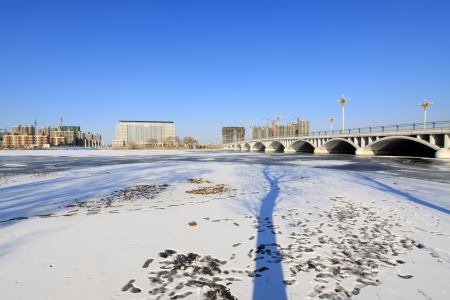 building and bridge construction landscape in the snow, north china photo