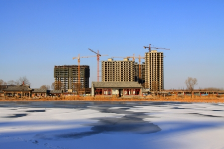 edge of the ice: Unfinished construction site in the ice river edge, North China