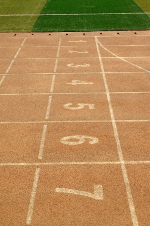 red plastic runway and numbers in a sports ground, in\ Beijing, China