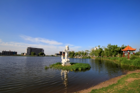 the humanities landscape: mermaid statue in a park, surrounding environment is very beautiful, in China