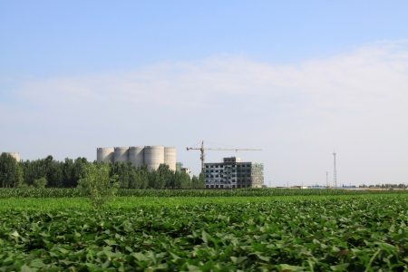 Farmland and unfinished building in the blue sky, China photo
