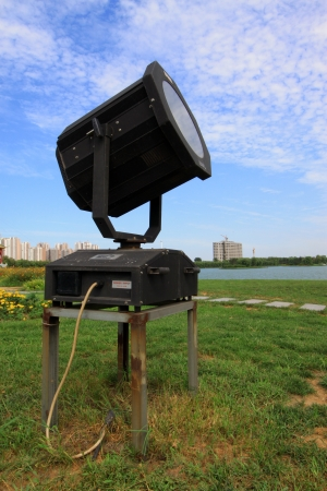 greening: searchlight on the grass in a park