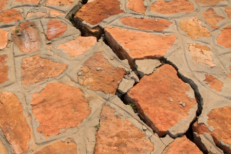 disrepair: closeup of pictures, crack of red stone wall