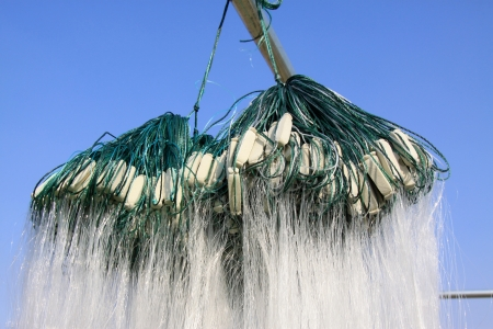fishing nets and float in the blue sky background photo