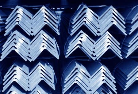raw material: closeup of steel angles bunch in warehouse Stock Photo
