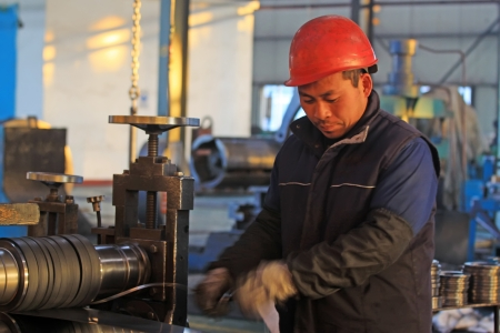 Luannan, November 19: A worker operating the machine, in Huifeng Steel Corp workshop, in November 19, 2012. Huifeng Steel Corp specializing in the production of hot rolled strip, is the largest local refined steel manufacturers.