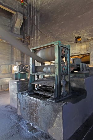 processing speed: compacting machinery equipment in an old factory