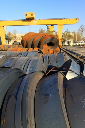 raw materials strip steel and crane, in a material field