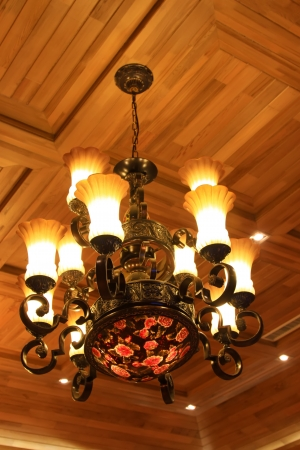 glass chandeliers hanging from the ceiling in a hotel photo