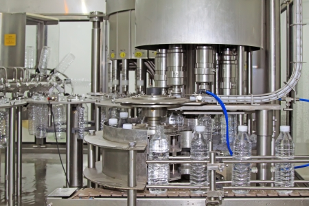 bottled mineral water production line in a factory photo
