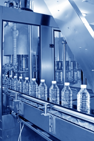 packaging industry: bottled mineral water production line in a factory Stock Photo