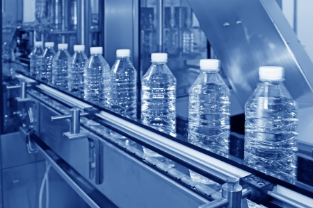 bottled mineral water production line in a factory Stock Photo