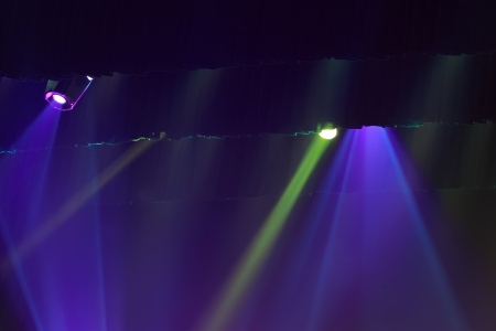 stage lighting effect in the darkness, closeup of photo photo