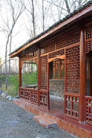 Traditional Chinese wooden building in a park, north China photo