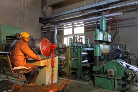 Luannan, November 19  A worker sitting at console operation, in Huifeng Steel Corp workshop, in November 19, 2012  Huifeng Steel Corp specializing in the production of hot rolled strip, is the largest local refined steel manufacturers