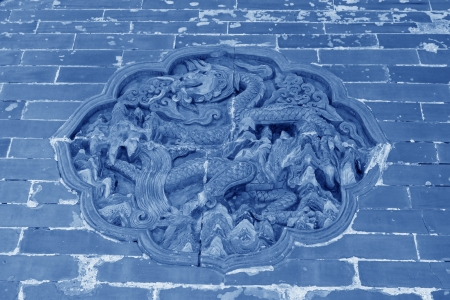 ZUNHUA - MAY 11: Dragon and Phoenix Gate glazed tile decoration in the Eastern Royal Tombs of the Qing Dynasty on May 11, 2013, Zunhua, Hebei Province, china. Sajtókép
