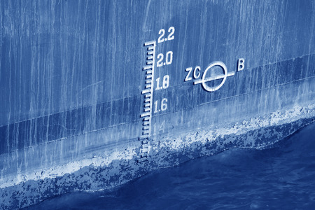 depth measurement: closeup of waterline marked on the ship Stock Photo