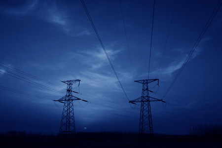 electric tower in the evening sky, power transmission facilities photo