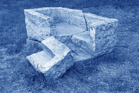 runnel: broken stone runnel in the grass, closeup of photo