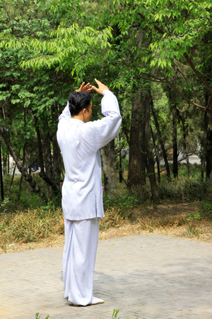 TANGSHAN - MAY 10: elderly practicing martial arts in a park on May 10, 2014, tangshan city, hebei province, China.  Stock Photo - 28690342